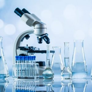 Science laboratory research and development concept. microscope with test tubes